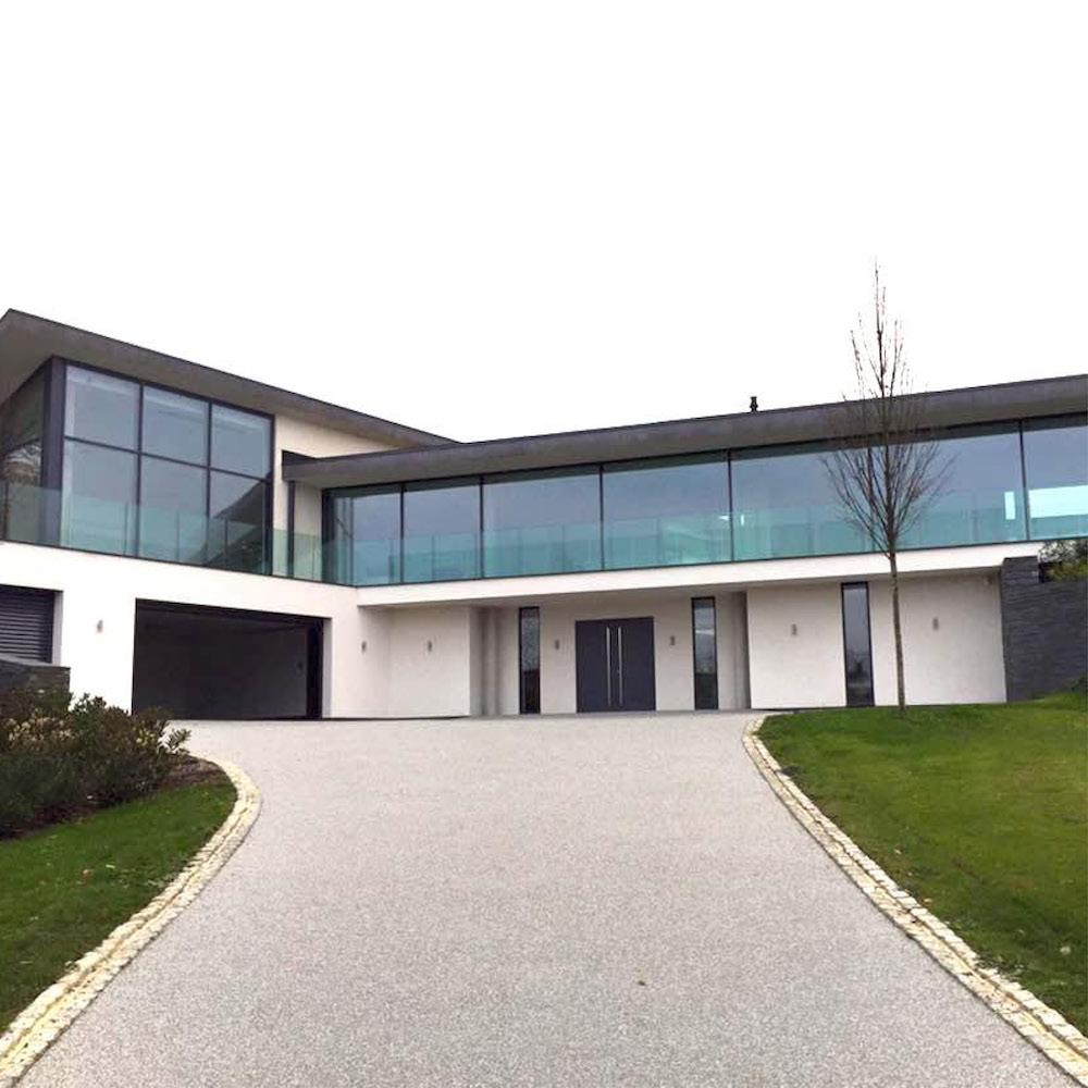 light grey resin drive modern property